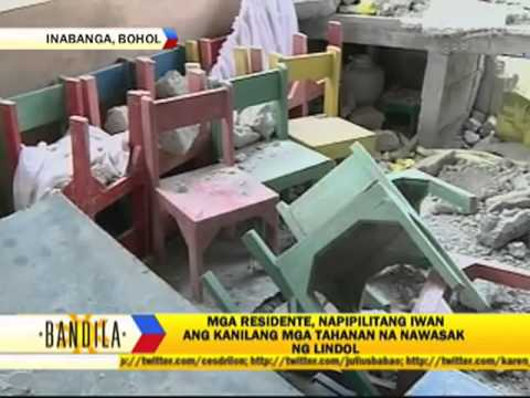 Earth swallows houses in Bohol village