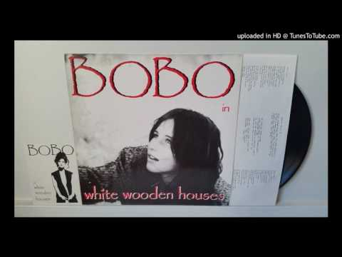 Bobo in White Wooden Houses  Aside of the Road