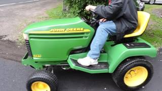 Dad getting first drive on the John Deere 345.