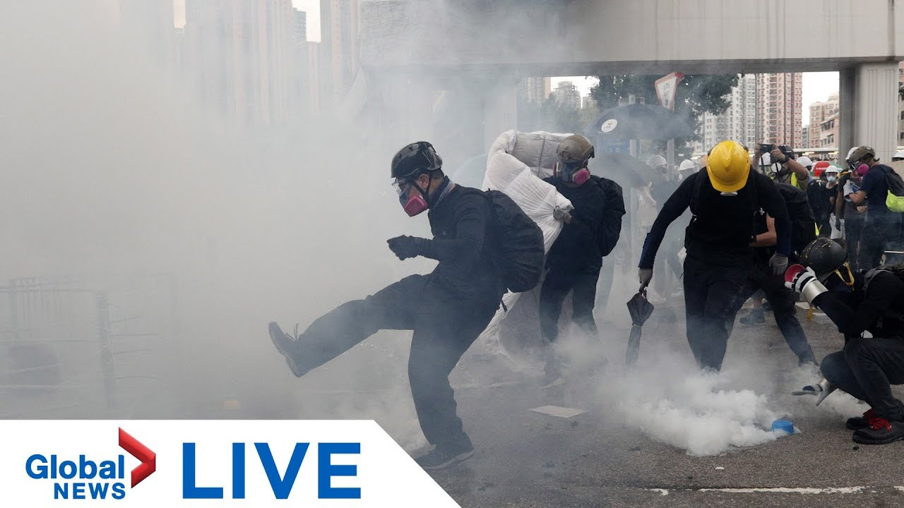 Hong Kong police fire tear gas into crowds of protesters after weeks of demonstrations | LIVE