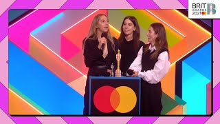 Haim wins international group at the brit awards 2021!the sisterly trio that is pick up award and thanks uk for being fi...
