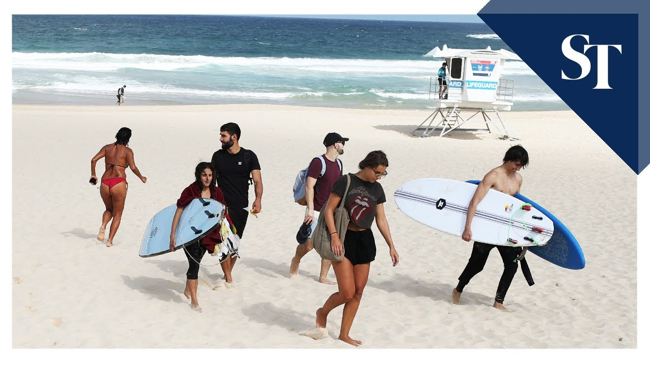 Bondi Beach closes after crowds defy virus rules