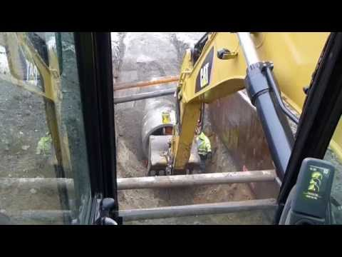 """Cat 330d digging and laying 60"""" concrete drain pipe"""