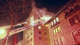 Crews investigate high rise apartment fire on East Side