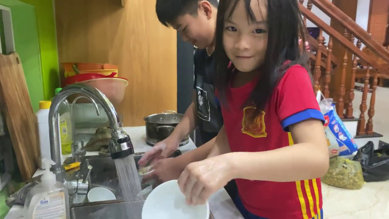 Children are washing dishes for mothers