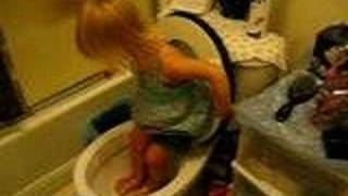 Emilie playing in the toilet