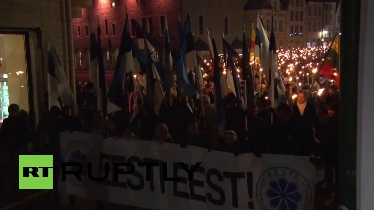 Estonia Soldiers Of Odin Hold Torch Lit March In Tallinn Youtube