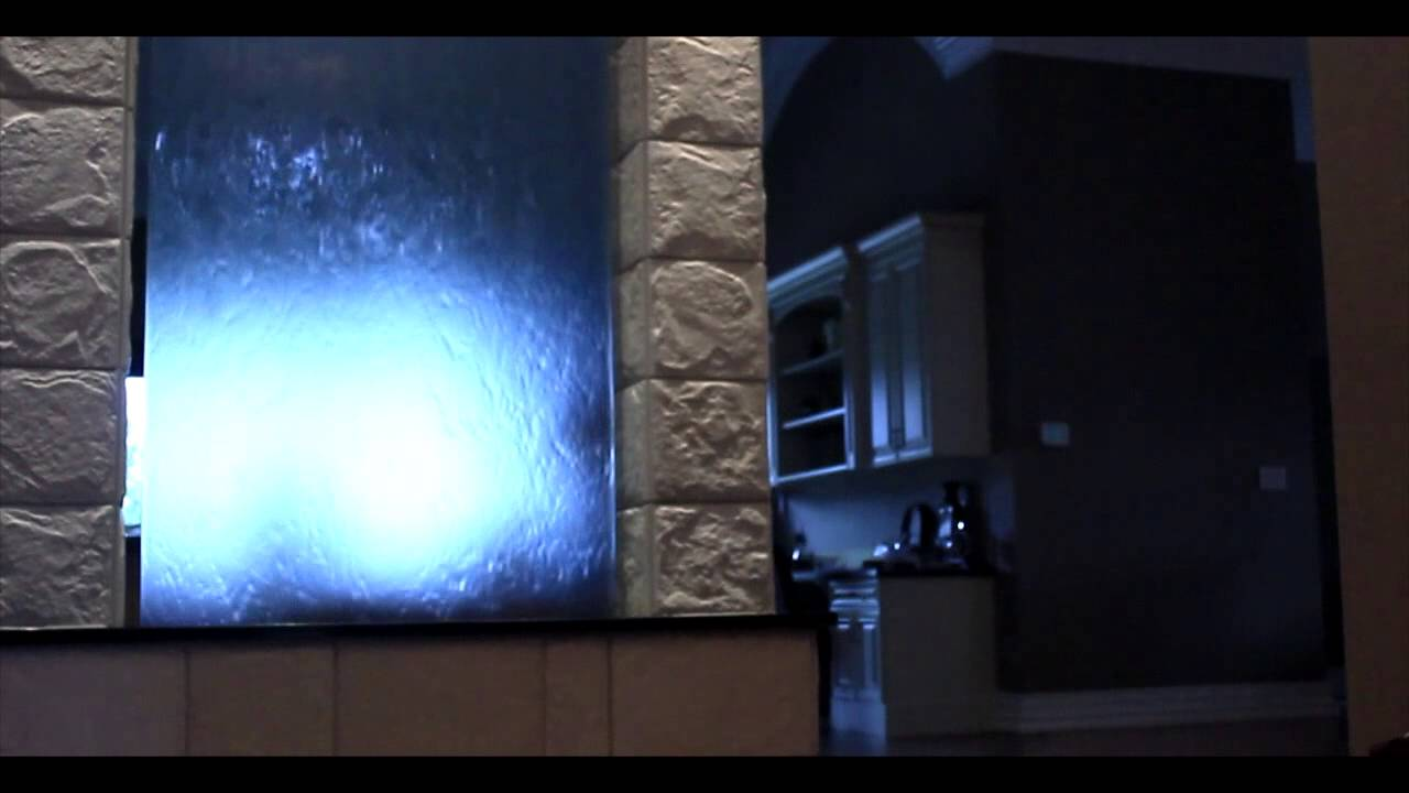 Indoor glass waterfall with 2 sided waterflow. 12 feet tall and 4 ...