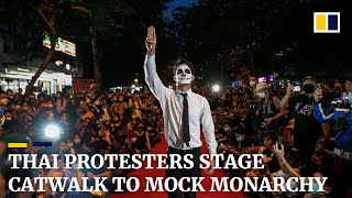 Thai protesters turn Bangkok street into catwalk to mock princess's fashion show