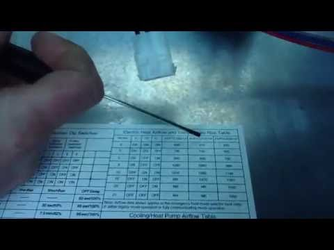 Showing how easy it is to set Dip Switches on Goodman AC Unit