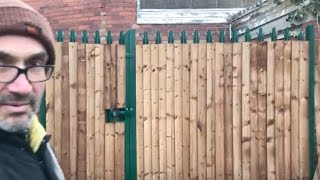 How to hide a metal fence with wood cladding, hiding metal fence