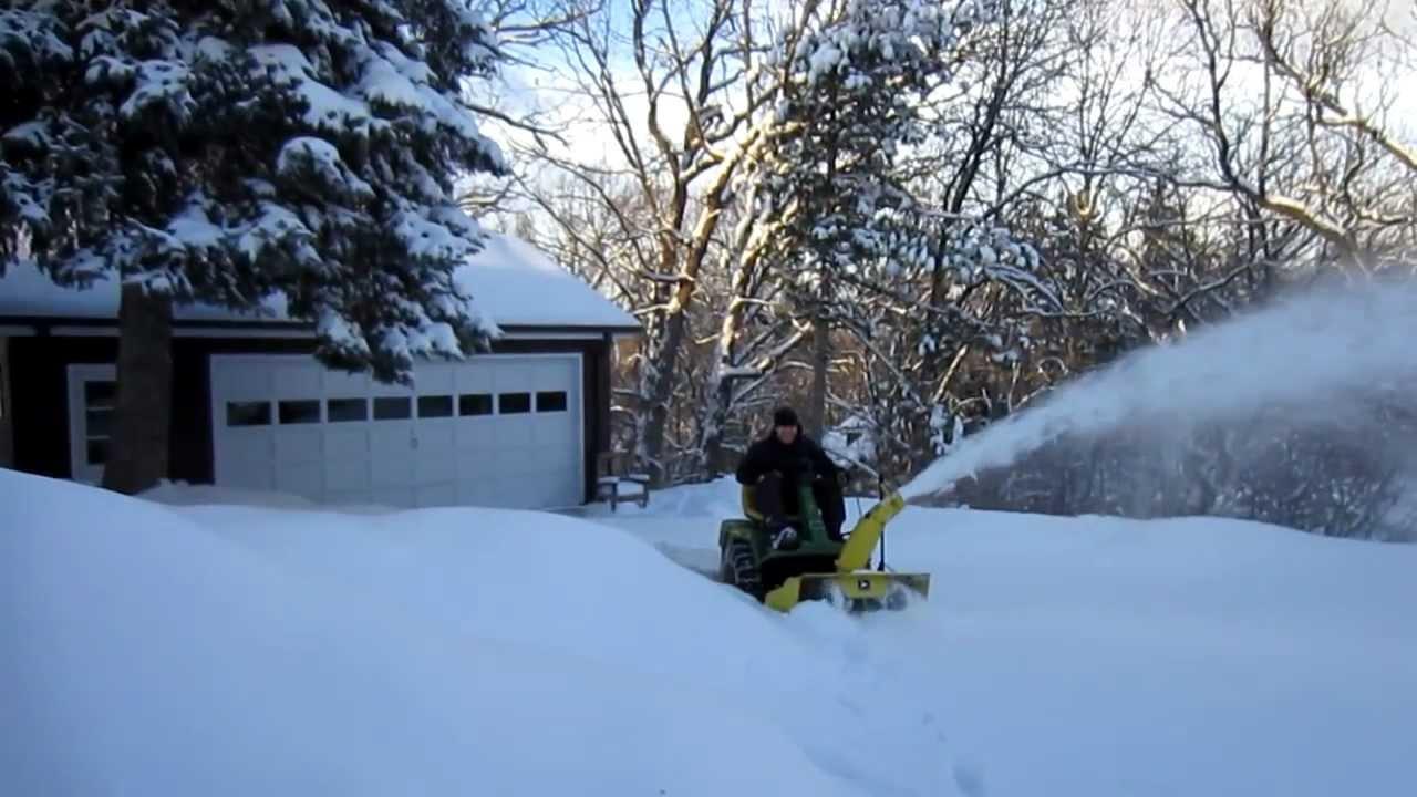 John Deere F525 Blowing Snow