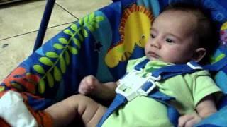 Baby watching a movie on Fisher Price Ocean Wonders Deep Blue Swing