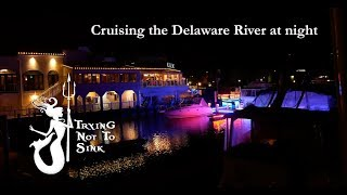 Night time cruising down the Delaware River and having our davit repaired.