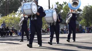 Criminals parade past house blowing horns and beating drums