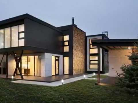 Modern box house with decorative wall made from natural for Modern box house design