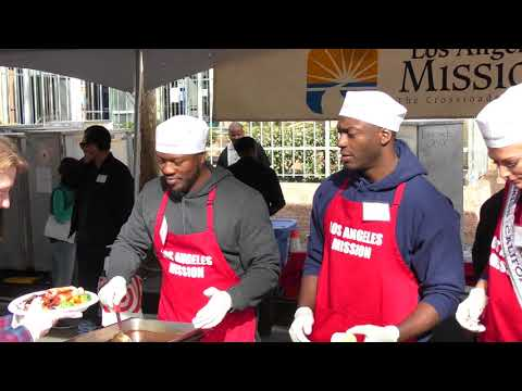 Aldis Hodge and Edwin Hodge at the Christmas Meal For The Homeless at LA Mission in Los Angeles