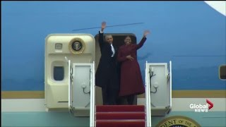 Outoing President Obama and his wife Michelle wave goodbye