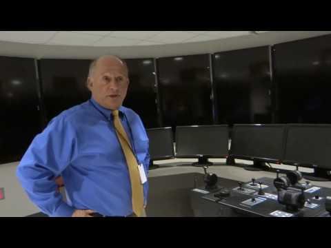Tom Schafer, superintendent of the Maritime Academy of Toledo, explains the school's ship simulator