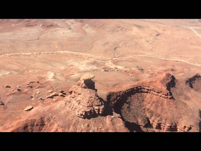 Flying over Mexican Hat rock formation in southern Utah