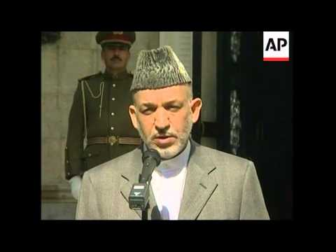 Karzai tries to reduce outrage over alleged desecration