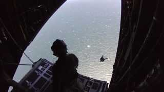 Air Force Pararescuemen Jump Into Pacific Ocean With Zodiac From MC-130P Combat Shadow Aircraft