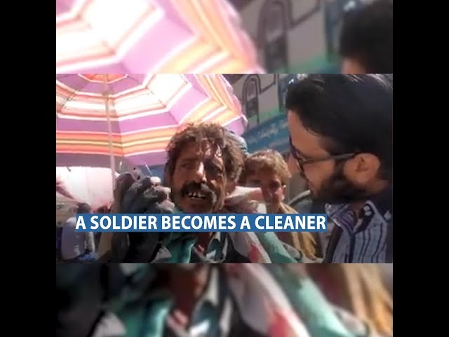 A soldier works in cleaning after salaries cut and the  currency collapse.
