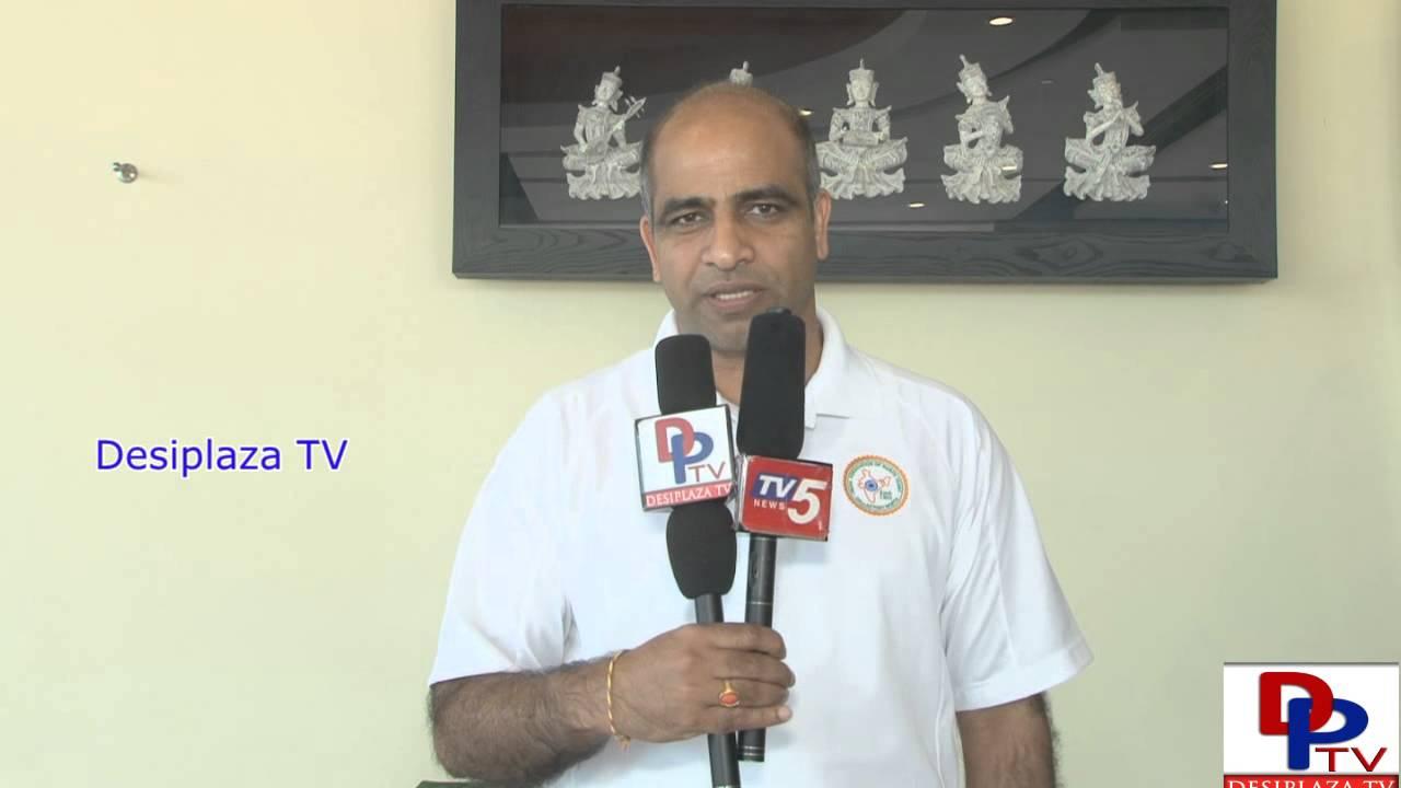 Dr.Sreenivas Gunukula,President of IANT,Dallas speaking to Desiplaza TV at Indian Consular Camp.