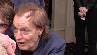 EXCLUSIVE: AC/DC Angus Young giving it to fans at George V hotel in Paris