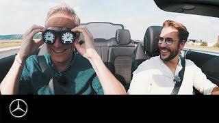 Matthias Malmedie und Maximilian Götz testen ihr Geschwindigkeitsgefühl im C-Klasse Cabriolet