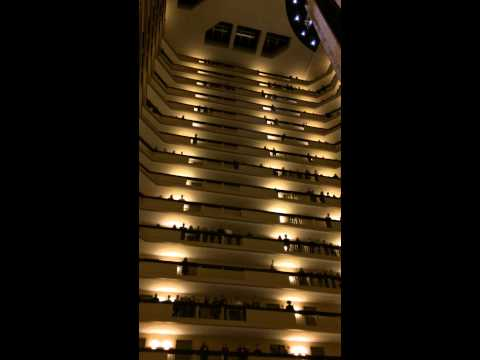 500 high school choir students sing the U.S. National anthem in a high rise hotel