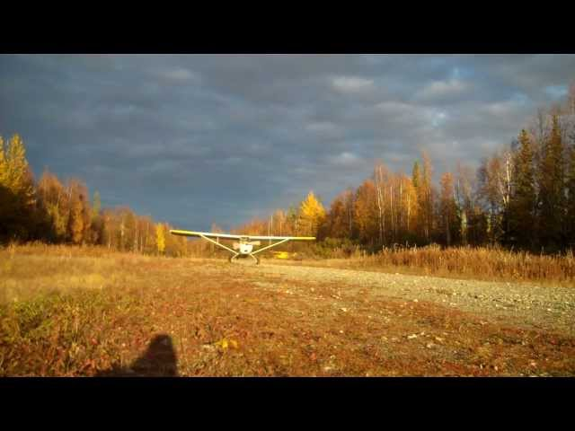 Alaska Flying: Takeoff into the sun at a private downhill airstrip