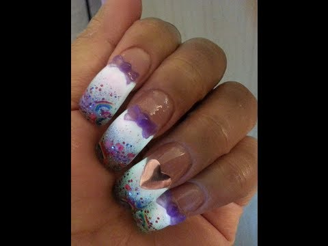 Acrylic Nails Using Cotton Candy Glow With A Rainbow Glitter