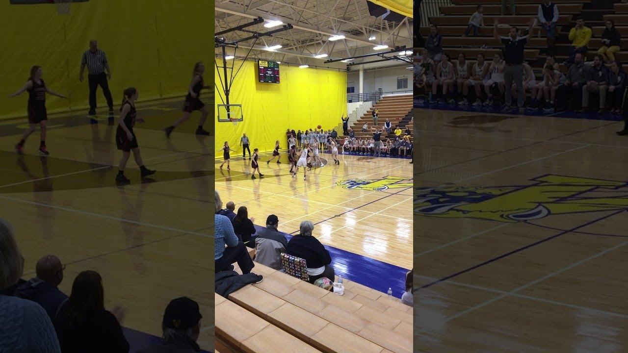 Epic Half-Court Shot at Basketball Game