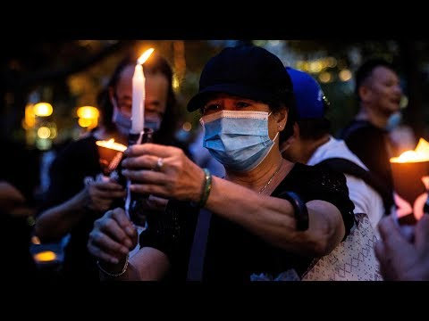 Crowds in Hong Kong defy ban to mark Tiananmen Square annive