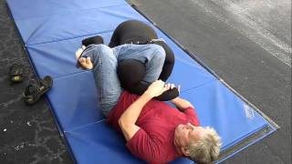 BJJ Black Belt on Submission Master Grappling Dummy