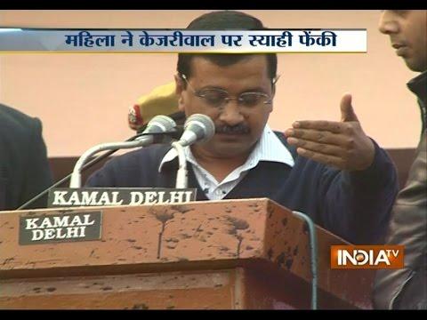 A Woman Throws Ink on Delhi Chief Minister Arvind Kejriwal in Delhi's Chhatrasal Stadium