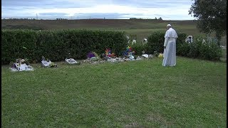 Pope Francis prays before the tombs of unborn babies in a Roman cemetery