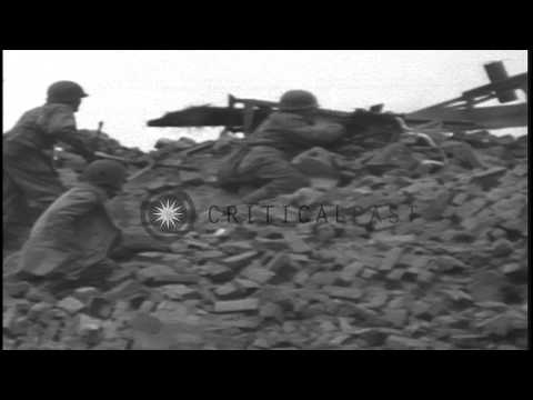 US soldiers firing machine guns and a German Panther tank is fired on and erupts ...HD Stock Footage