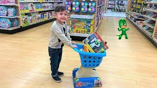 Zack Shopping for Toys at the toy store with kids size shopping cart