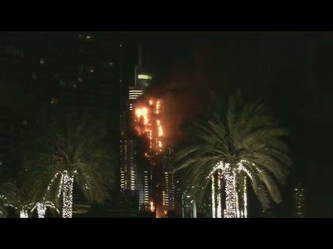 Dubai high rise burning near New Year's Eve fireworks display