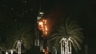Dubai high rise burning near New Year's Eve fireworks display