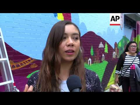 Migrants in Mexico create a mural to tell their stories