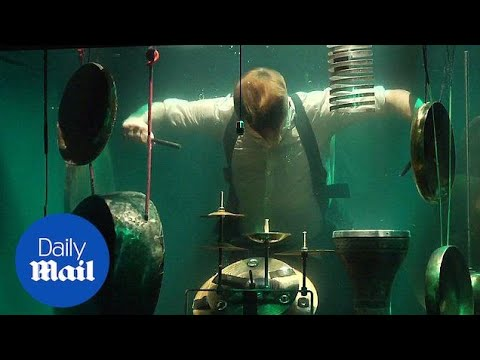 Listen to the world's first UNDERWATER band in Netherlands - Daily Mail