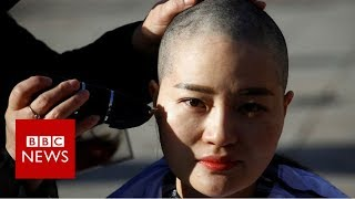 Shaving their heads in protest - BBC News