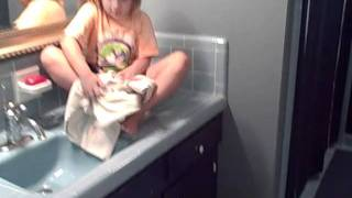 Using A 2 Step Stool To Help A Kid Reach The Bath Sink