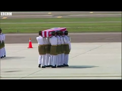 MH17: First Malaysian bodies arrive home, BBC News