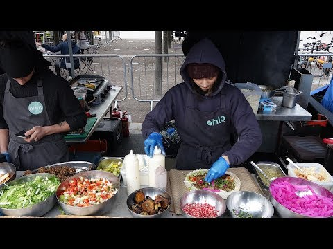 Falafel sandwich wraps - delicious eastern mediterranean street food from ehla eat stall, london.. mp3