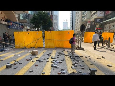 Hong Kong protesters create barricades, place bricks in Kowloon | AFP