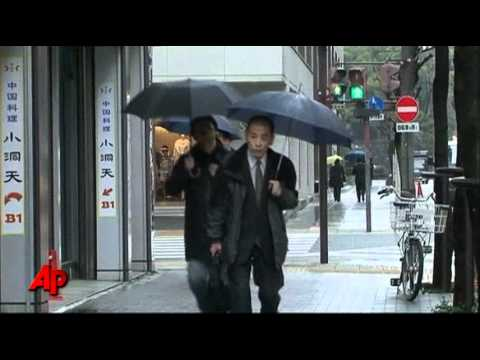 Japan Slowly Recovers, Mourns Dead